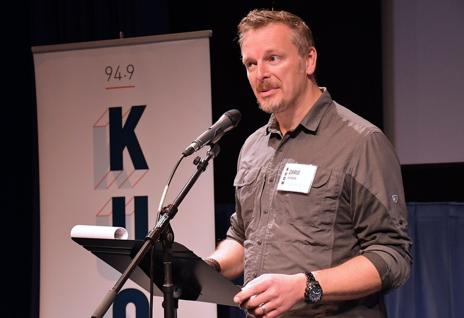 caption: Chris Morgan, host of 'The Wild',  performs his story 'The Land of Giants' at KUOW's Stories from the Wild event on Friday, October 11, 2019 at McCaw Hall in Seattle.