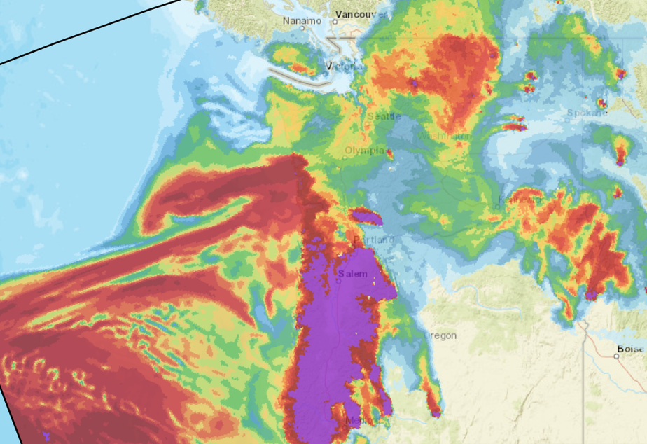 caption: A screenshot from the NOAA HRRR-Smoke forecast site shows a huge mass of smoke offshore in the Pacific southwest of Washington state, along with a large band in Oregon, early Thursday, September 10, 2020.