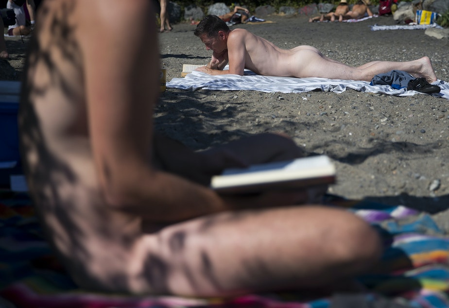 caption: Beachgoers read on Monday, August 27, 2018, at Denny Blaine Park in Seattle.