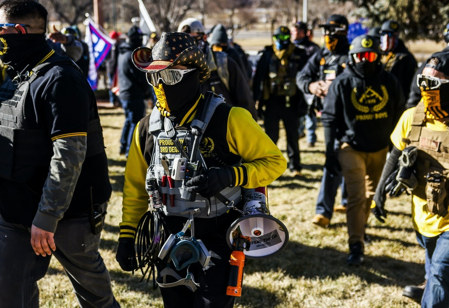 """caption: Public Safety Canada is calling the Proud Boys a terrorist group, noting that last month, its members """"played a pivotal role in the insurrection at the U.S. Capitol."""" Here, Proud Boys members join Donald Trump supporters at a protest outside the Colorado State Capitol in Denver."""