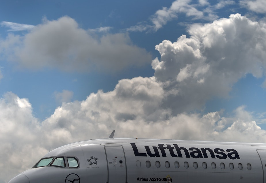 caption: An Airbus aircraft of the German airline Lufthansa is parked at the Franz-Josef-Strauss airport in Munich, Germany, earlier this month.