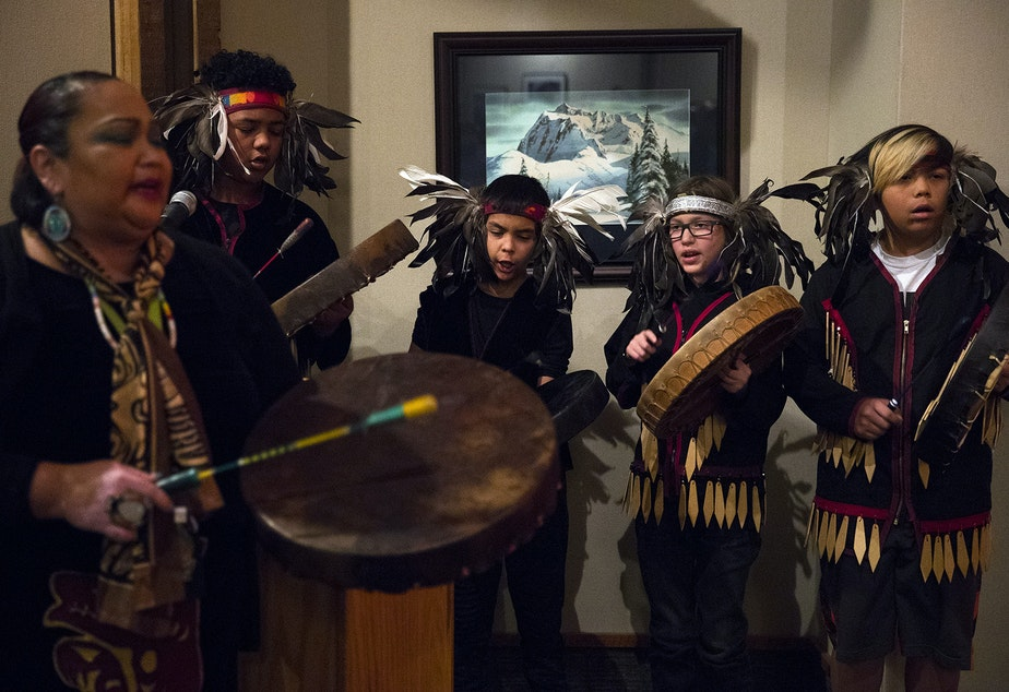 The Lummi Blackhawk Singers sing the Lummi national anthem on Wednesday December 5, 2018, before the fisher release at the North Cascades Visitor Center in Newhalem.