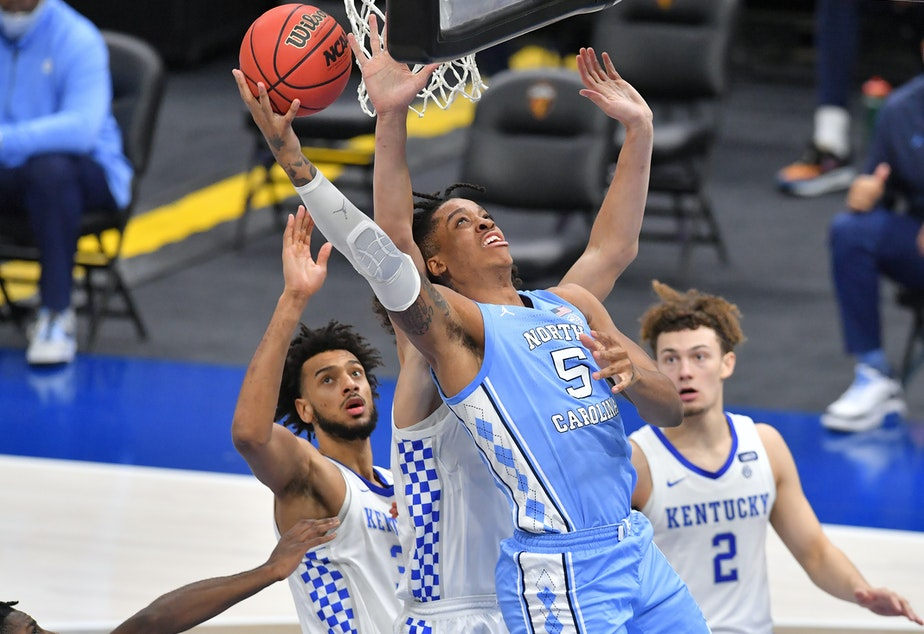 caption: The University of North Carolina is the first school to organize group licensing deals for its players.