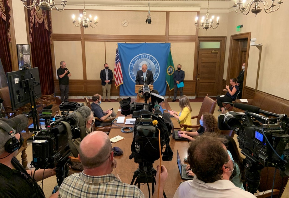 caption: Gov. Jay Inslee speaking during press conference Aug. 18 announcing a vaccine mandate for people who work in K-12.