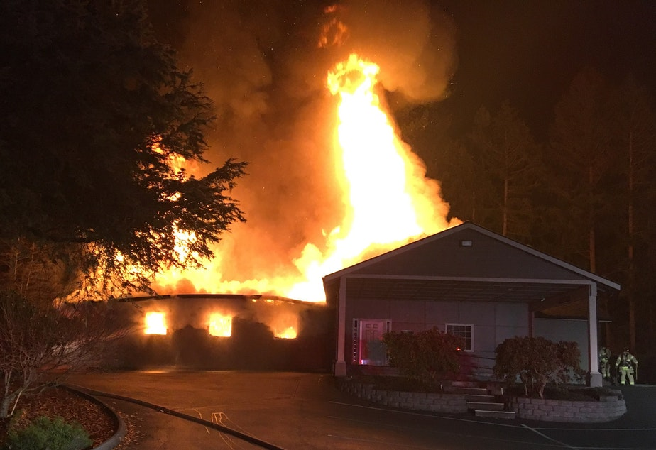 Flames leap from the Kingdom Hall of Jehovah's Witnesses in Lacey early Friday morning. Firefighters said the building was a total loss.