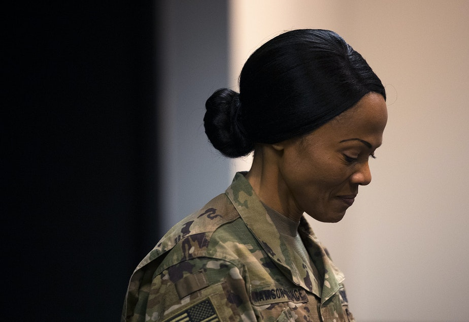 """caption: Col. Hope Williamson-Younce, commander of the 627th Hospital Center, speaks during a press conference on Tuesday, March 31, 2020, at the CenturyLink Field Event Center in Seattle. """"Within 48 hours of notification, we answered the nations call,"""" said Col. Williamson-Younce. """"We have medical doctors, nurses and support staff from all over the nation. They have mobilized in a moment's notice to support our brothers and sisters here in Seattle, Washington."""""""