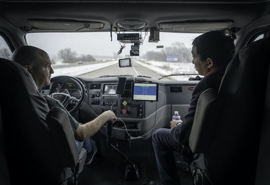 caption: Andrew Yang with a Truck Driver in Altoona, Iowa
