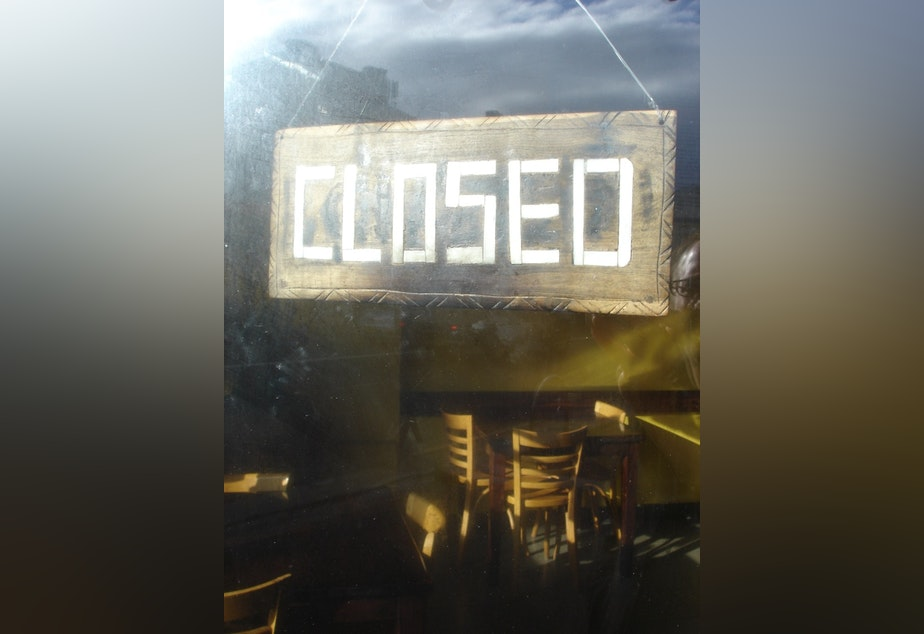 caption: Closed sign hanging in restaurant window