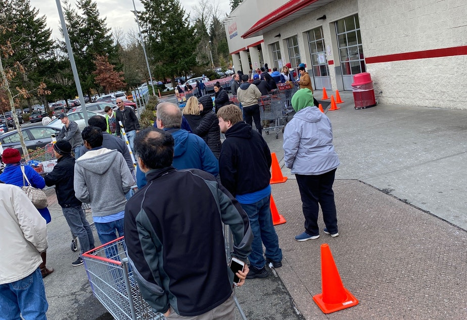 caption: Early-morning customers at the Kirkland Costco had a bit of a wait to shop Saturday, March 14, 2020. After a rough count, one KUOW listener estimated that about 150 people were waiting in line to enter the store when it opened.