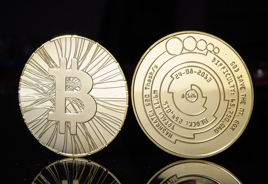 caption: Not a real bitcoin: the currency doesn't have a physical form; pictures like this are novelty items that often have bitcoin information on them.