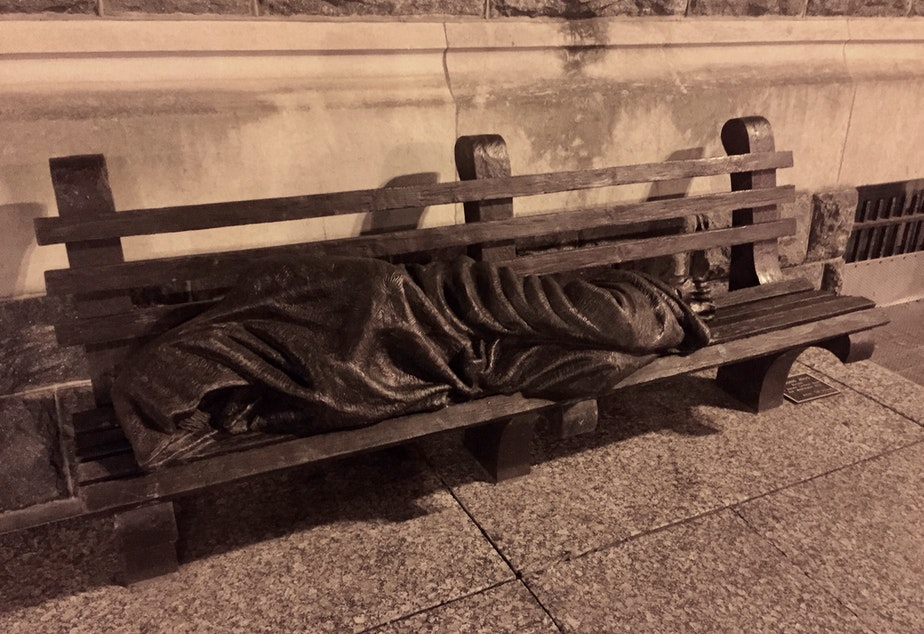 caption: This statue depicting Jesus as a homeless person has been replicated in cities around the world, including Seattle.