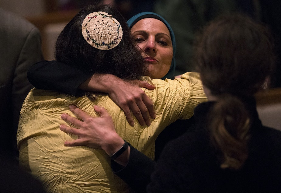 caption: Rabbi Jill Borodin, left, hugs Aneelah Afzali, with the Muslim Association of the Puget Sound, during a community vigil for Pittsburgh on Monday, October 29, 2018, at the Temple De Hirsch Sinai on 16th Avenue in Seattle.