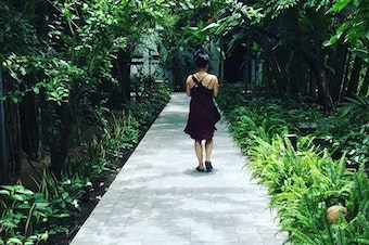 Thanh Tan walking down a pathway in Hoi An, a city on the central coast of Vietnam.