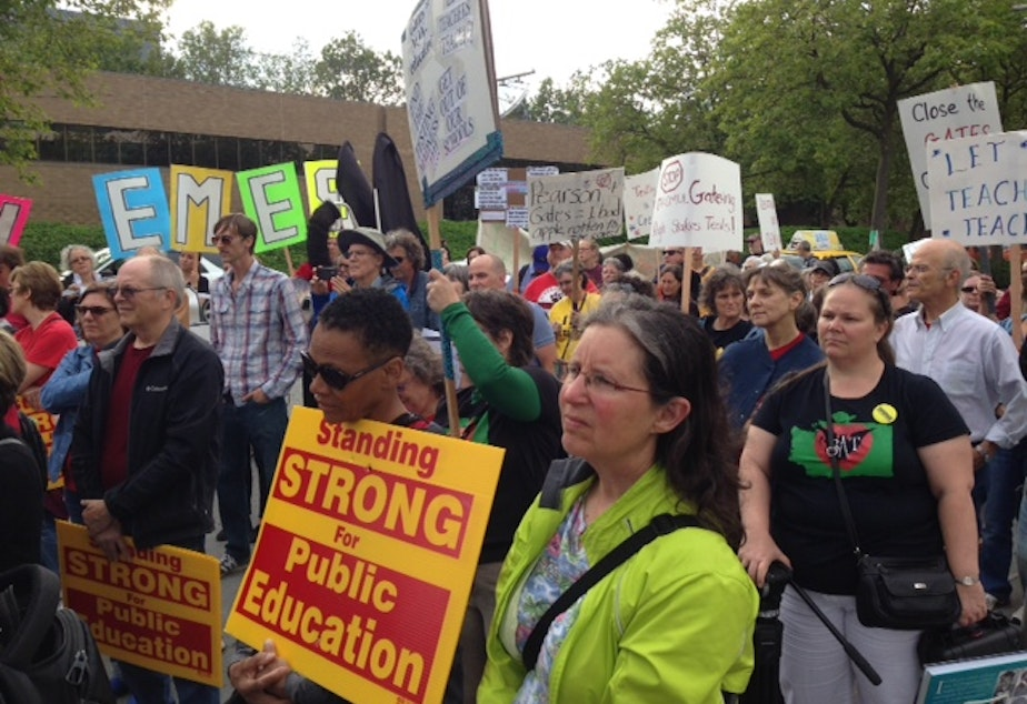 caption: Teachers rally outside the Gates Foundation to demand changes to the organization's education strategies