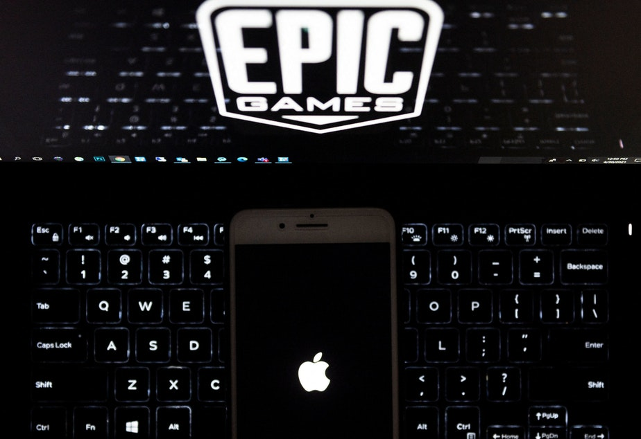 """caption: Epic Games, creator of the popular game """"Fortnite,"""" accuses Apple of running its App Store as an illegal monopoly because it only allows in-app purchases on iPhones to be processed by Apple's own payment system. The trial outcome could have far-reaching consequences for Silicon Valley and the future of how money moves on smartphones and other devices."""
