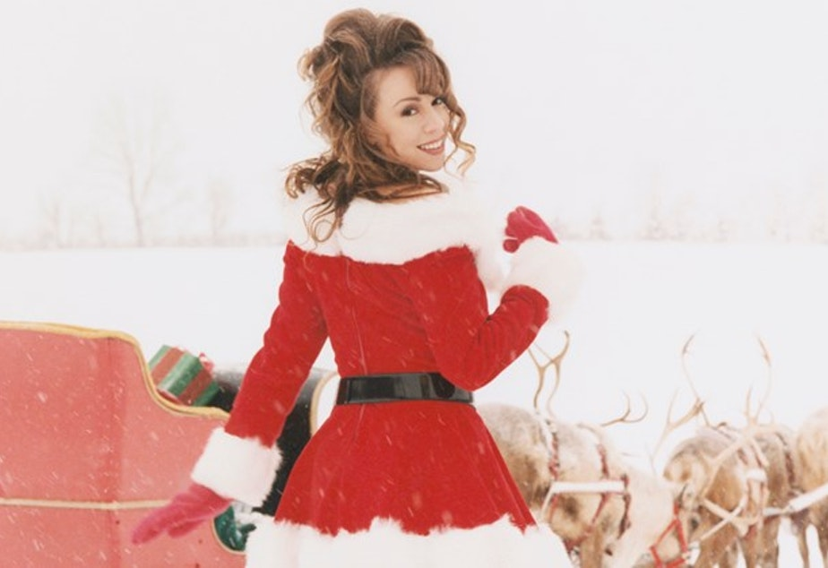caption: Mariah Carey throws it back for a classic - and now champion - Christmas song.