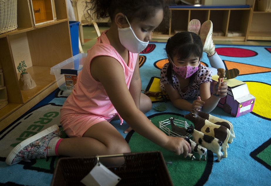 caption: Students in the kindergarten readiness summer program play together on Thursday, July 16, 2020, at the Denise Louie Education Center along Beacon Avenue South in Seattle.