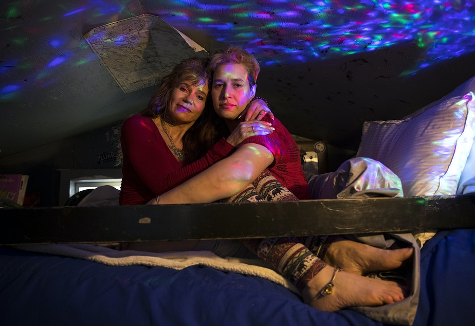 Rene Reynoso, left, and Cheyenne Reynoso, right, embrace on the bunk bed in their tiny home on Wednesday, March 21, 2018, at the Licton Springs Tiny House Village on Aurora Avenue North in Seattle.