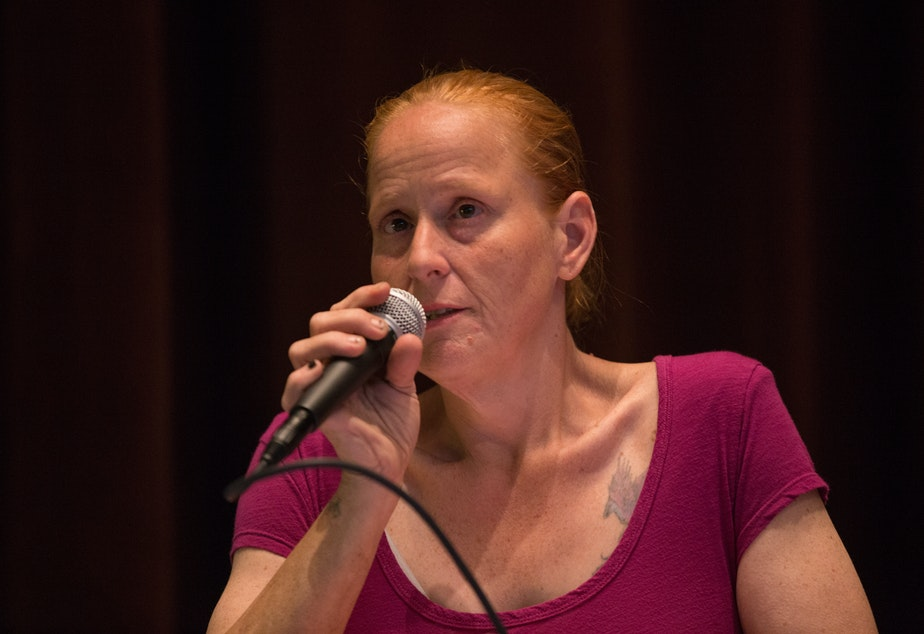caption: Brandie Osborne, a resident of the Jungle, speaks at a KUOW event at Seattle Public Library about the city's plan to partner with the Union Gospel Mission to clear out the Jungle.