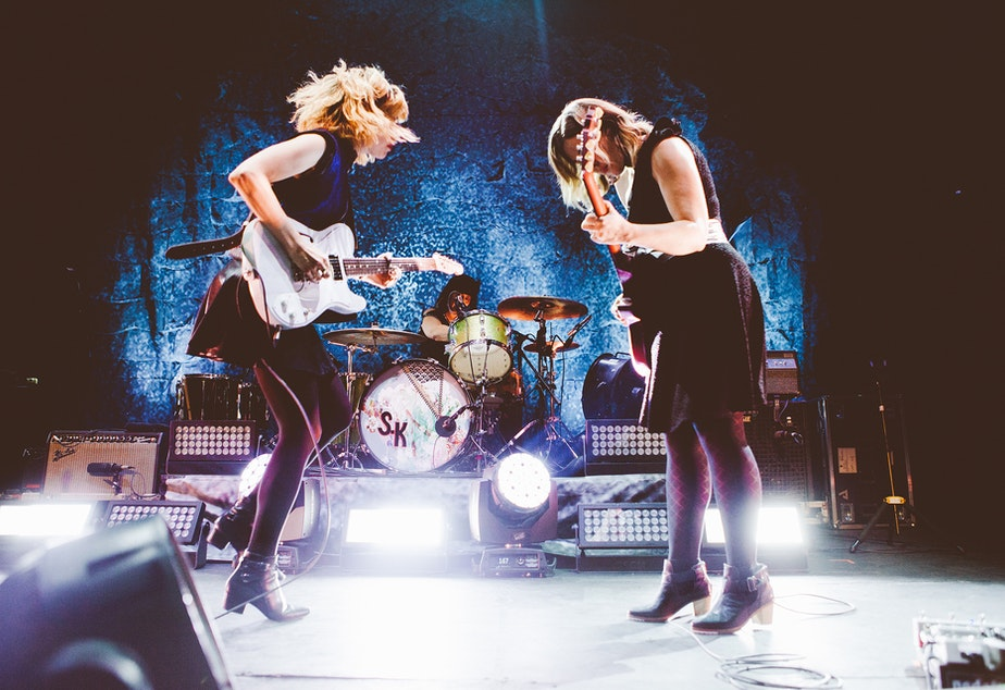 caption: The prolific feminist punk trio Sleater-Kinney formed in Olympia, Washington and signed to Sub Pop in 2005 with their seventh release, The Woods. They are currently signed to Mom+Pop Records.