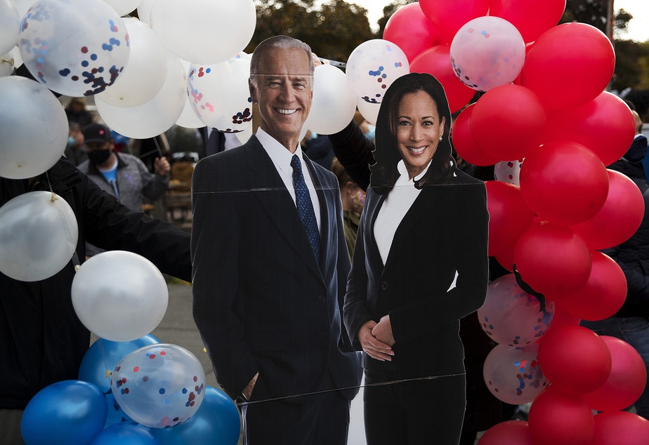 caption: Cardboard cutouts of Joe Biden and Kamala Harris are displayed during an impromptu celebration after the results of the 2020 presidential election were made official on Saturday, November 7, 2020, near the intersection of 10th Avenue and East Pine Street in Seattle.