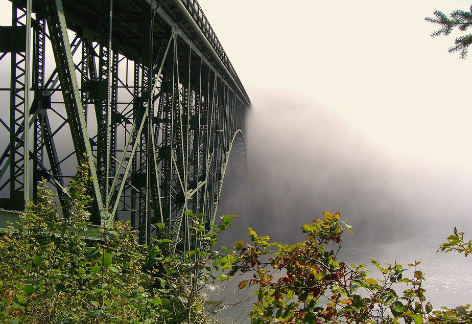 caption: The bridge at Deception Pass, between Whidbey Island and Fidalgo Islands. It got its name from Captain George Vancouver, who felt deceived by the width of the waterway.