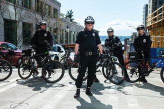 FILE: Police officers at a 2017 rally in downtown Seattle.