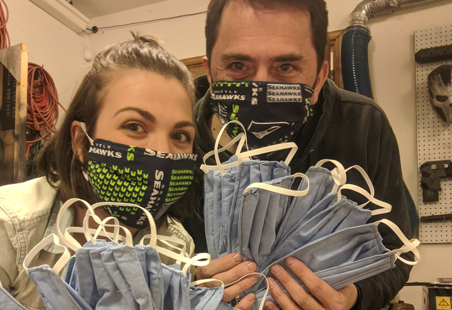 caption: Hannah Ferguson and Brian Morris with face masks they made at Zak Labs in Renton.