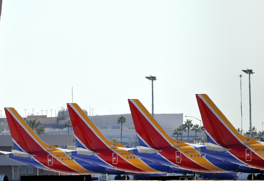 caption: Boeing 737 Max jets are grounded at Sky Harbor International Airport in Phoenix on March 14.