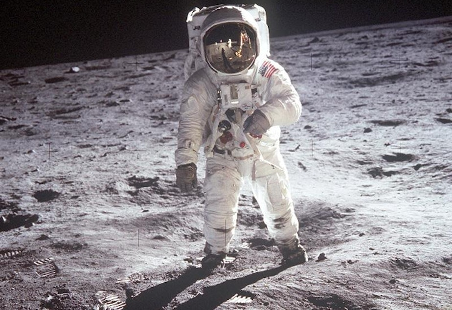 caption: Buzz Aldrin walks on the moon in 1969.