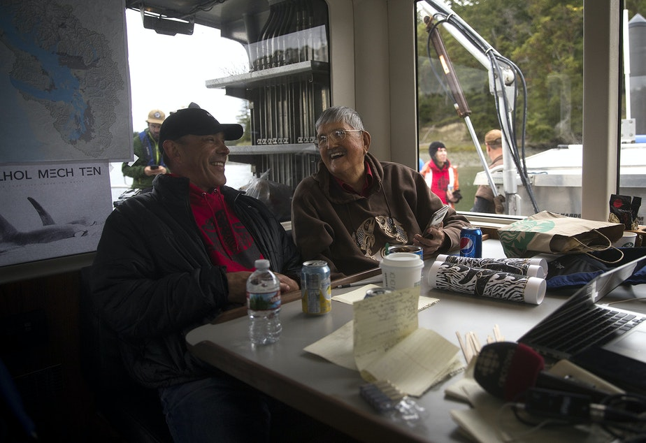 Lummi Nation hereditary chief Bill James, right, laughs with Lummi Tribal Chairman Jay Julius aboard King County Research Vessel SoundGuardian on Wednesday, April 10, 2019, near San Juan Island.