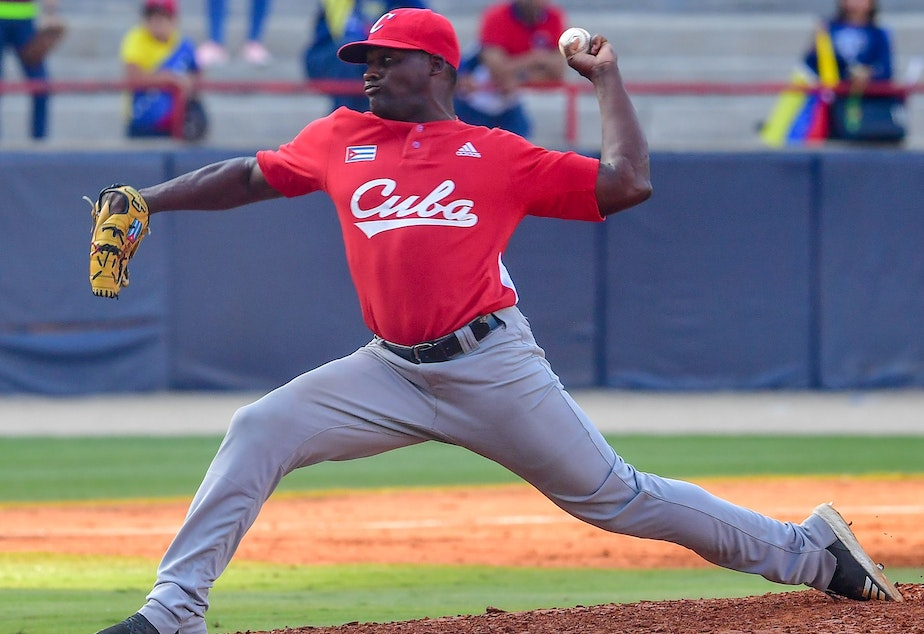 caption: Alexis Rivero of Cuba's Las Tunas Leñeros pitches during a Caribbean Series match against Venezuela's Cardenales de Lara in Panama City on Feb. 6. Major League Baseball had made a deal with Cuba's baseball federation to allow Cuban players to play in the U.S. without defecting, only to see the Trump administration subsequently block the rule.