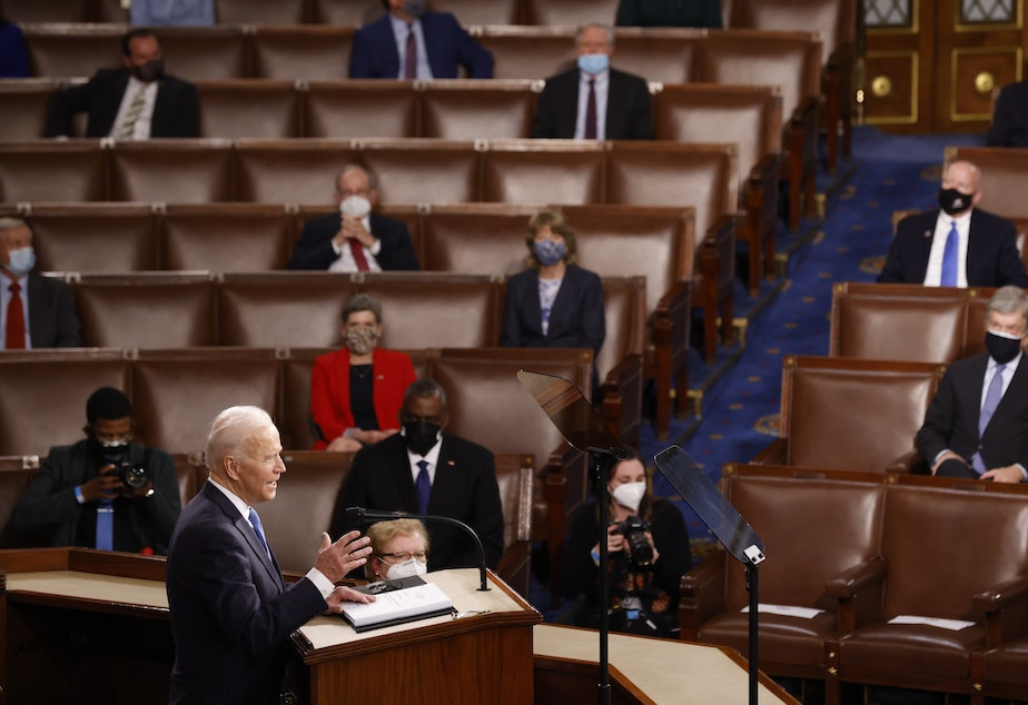 caption: WASHINGTON, DC - APRIL 28: President Joe Biden addresses a Joint Session of Congress, with Speaker of the House Nancy Pelosi and Vice President Kamala Harris behind, on Capitol Hill in Washington DC.