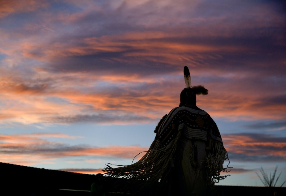 caption: A woman performs a traditional Native American dance during the North American Indian Days celebration on the Blackfeet Indian Reservation in Browning, Mont., Friday, July 13, 2018. CREDIT: DAVID GOLDMAN/AP