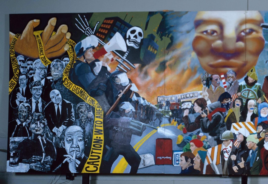 WTO mural created by Lauren Holloway, Erin Koch, Yoona Lee, Cause B, and Verse Omega.