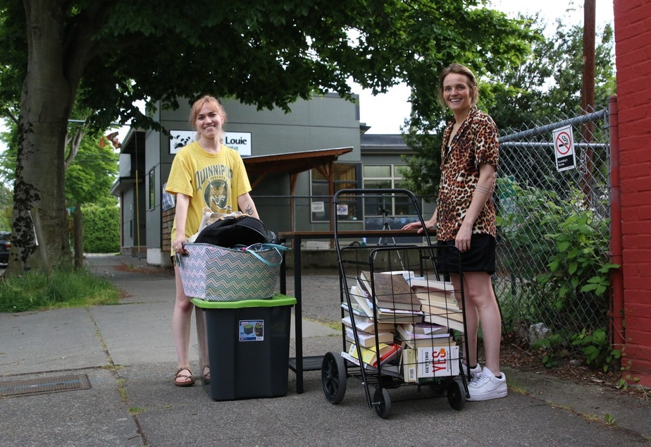 caption: Kate Huntington, left, on moving day. Huntington had lived in Portland, Oregon, but was promoted. She moved to Seattle during the pandemic.