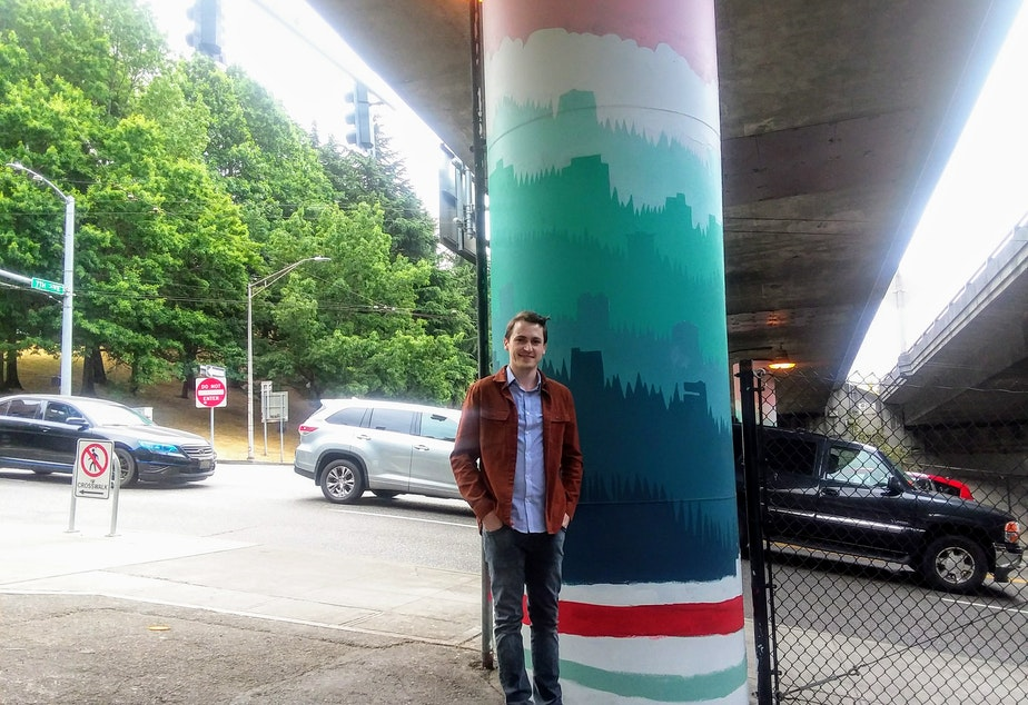 caption: Nathan Watkins, the designer of 68 Interstate 5 pillars between Cherry and James Streets in downtown Seattle.