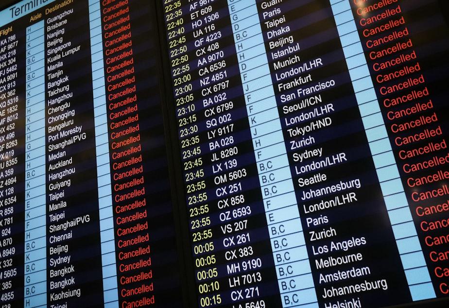 An information board shows canceled flights at Hong Kong's international airport.