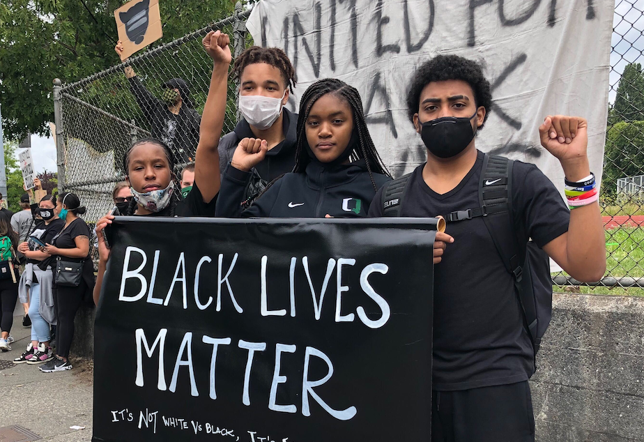 caption: Franklin High School students (L-R) Araeya Reed, Deon Hair, Jr., Mya Jones and Giovanni Olibrice protested police brutality on June 5th, 2020.