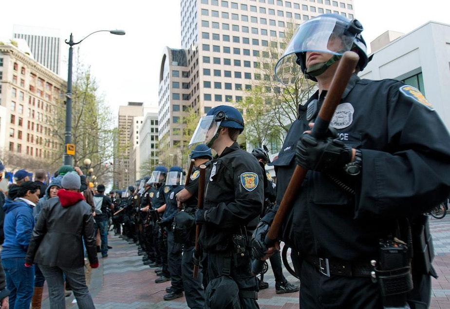 caption: Seattle Police at the 2012 May Day demonstrations.
