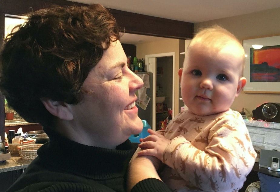 caption: Megan Moffat Sather and her daughter, Winslow