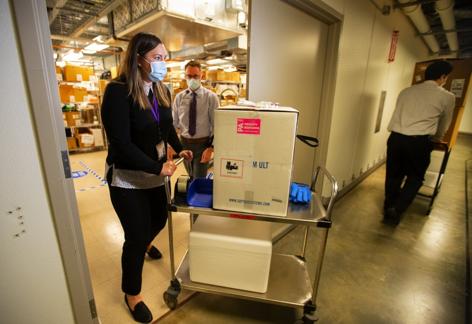 caption: The first shipment of COVID vaccines arriving at the UW Medical Center in Seattle on December 14, 2020.