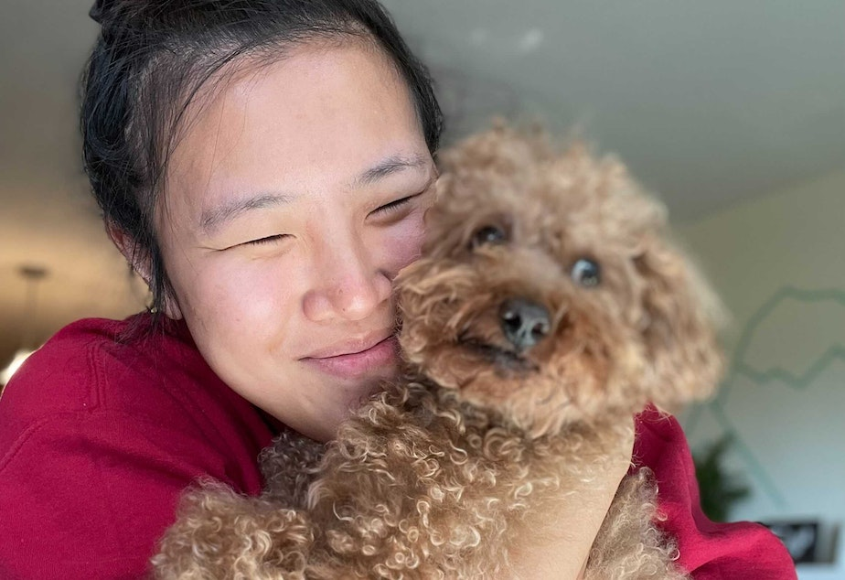 caption: KUOW staffer Lisa Wang hugging her pup Franklin.   UW psychology professor Nicole McNichols says people need touch, but not all touch has to come from other people. She says pets can provide much needed comfort and contact too.