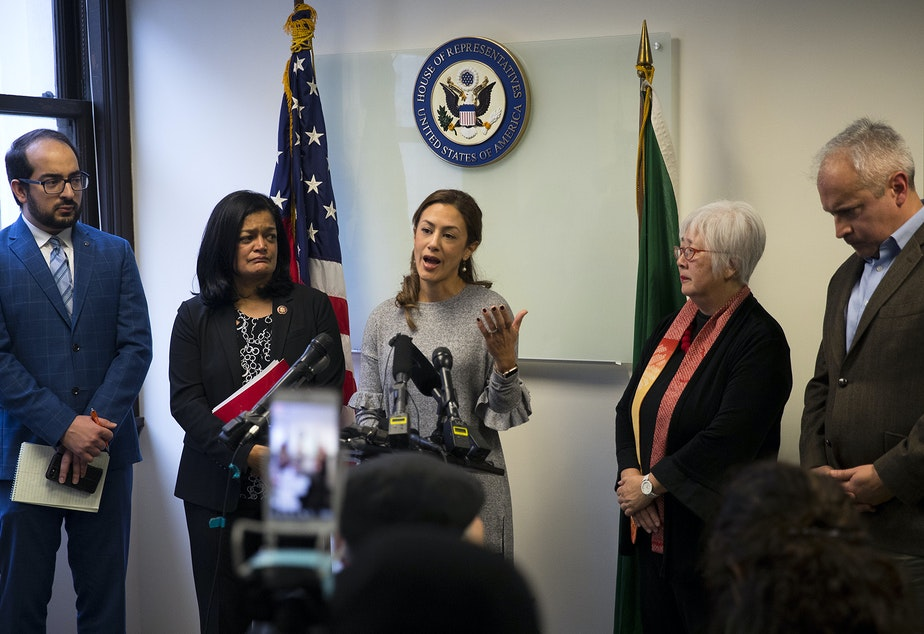 caption: Negah Hekmati, 38, speaks during a press conference detailing her 5-hour delay returning to the U.S. from Canada with her family, at Rep. Pramila Jayapal's office on Monday, January 6, 2020, in downtown Seattle.