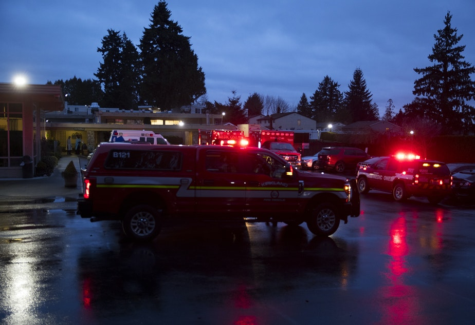 caption: Ambulances respond to the Life Care Center of Kirkland on Monday, March 2, 2020, in Kirkland.