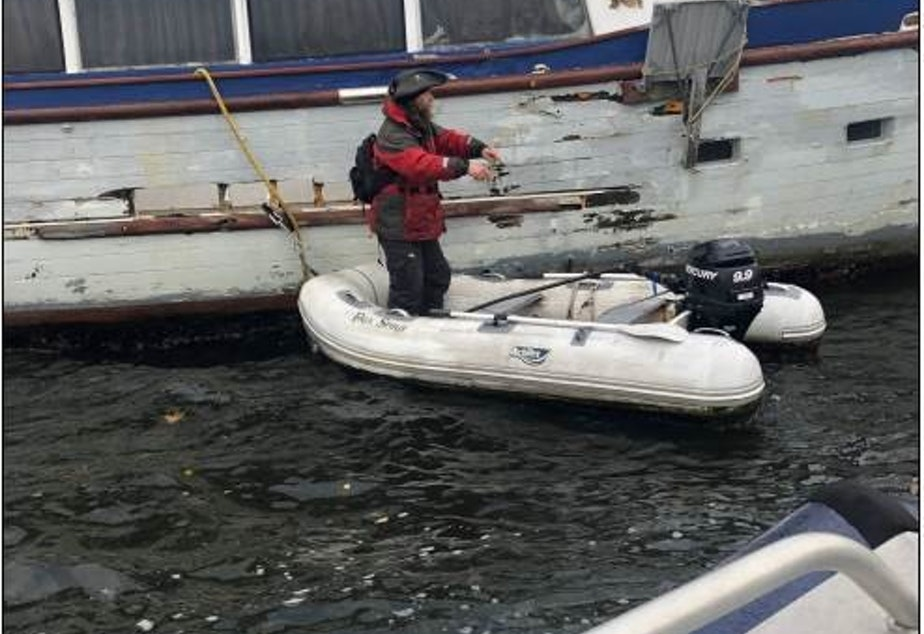 """caption: From Carol Tripp, executive director of the Port of Poulsbo:   """"We have had an ongoing issue with vessels anchored out in Liberty Bay during the winter months (not as much in the summer time). The vessels rarely have insurance coverage and usually are in less than desirable condition.   Here is a vessel that broke anchor out in the bay and ran ashore, against some rocks. The City of Poulsbo and the Port of Poulsbo came into assist."""