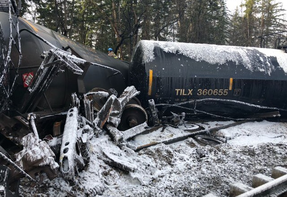 caption: Derailed tanker cars in Custer on Dec. 23, each holding about 29,000 gallons of crude oil