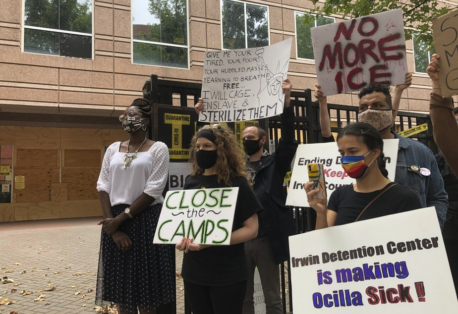 caption: Dawn Wooten (left), who filed the whistleblower complaint about conditions at the Irwin County Detention Center, participates in a news conference Tuesday in Atlanta.