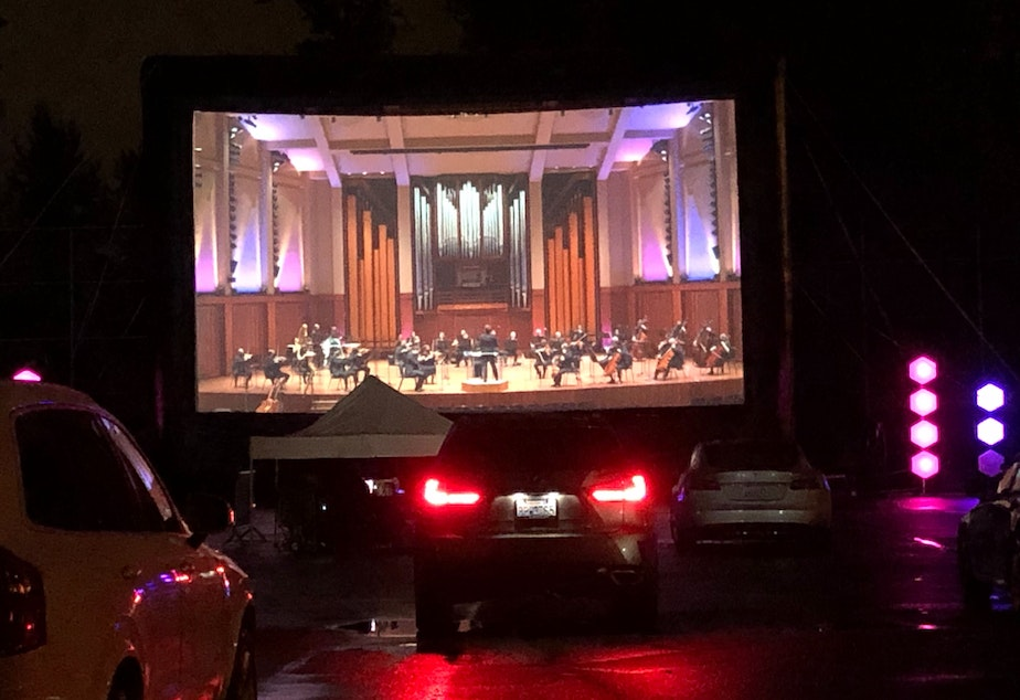 caption: For the Seattle Symphony's kickoff concert Sept. 19, audience members watched online or from a drive-in at Marymoor Park.