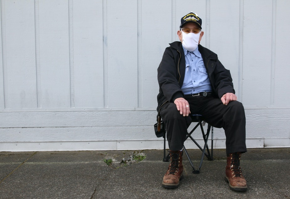 caption: Sailor Campbell waits for a bus on MLK in Tacoma's Hilltop neighborhood